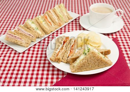 Light lunch of sandwiches with various fillings A light lunch of different sandwiches with a cup of tea