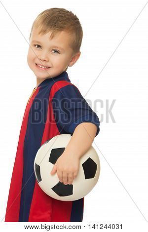Portrait of little boy football player in a striped uniform. Boy holding a soccer ball. Close-up - Isolated on white background