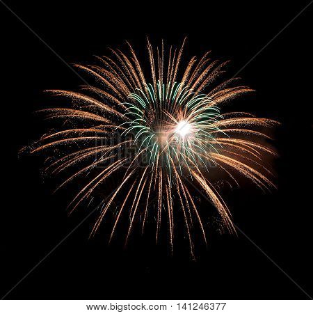 Red fireworks isolated in dark background. Multicolored fireworks isolated in dark background close up with the place for text, Malta fireworks festival, 4 of July, Independence day, New Year, explode