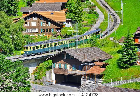Cogwheel train from Kleine Scheidegg station moves to Lauterbrunnen. Switzerland.