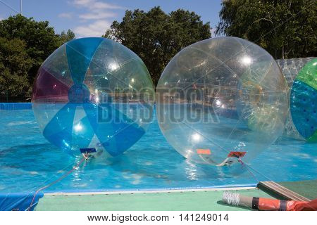 Inflatable balloon on the water. The ball in the water - a fascinating attractions for children. Water zorbing.