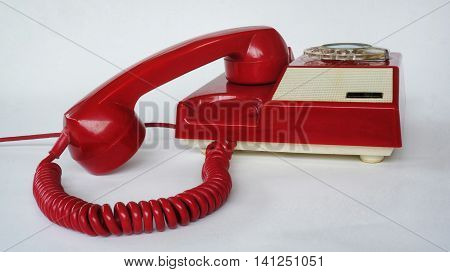 Red phone. Old red chinese telephone. Photography of vintage fix line phone.