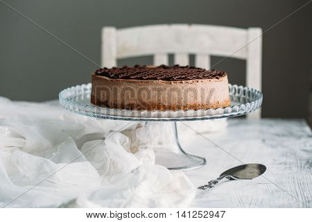 Chocolate cheesecake on a white background. Food style