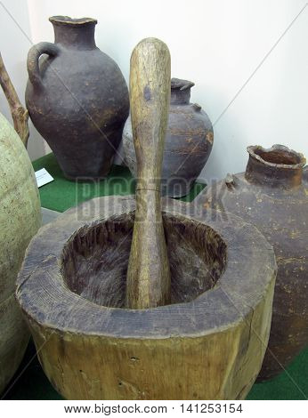 Lazarevskoe, Russia - June 26, 2014: Large old mortar and pestle made of wood