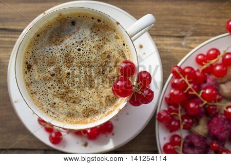 coffee Cup with cinnamon and fresh berries currant and raspberry