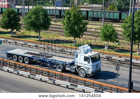 empty truck without cargo in seaport, shipping and transportation concept
