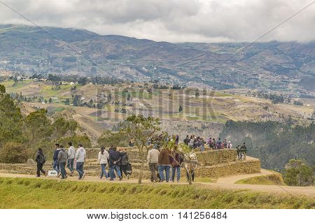 INGAPIRCA, ECUADOR, NOVEMBER - 2015 - Group of tourists at Ingapirca a touristic location in which is located an ancient inca temple located in Azuay province Ecuador