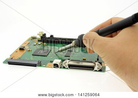 hand soldering solder of electronics board repairs or manufacturing.