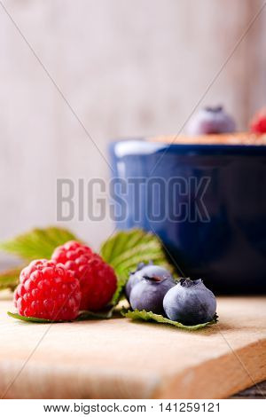 Red And Blue Berries On Chopping Board