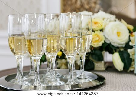 many of the champagne glasses on the table. Soft Focus Selective Focus.