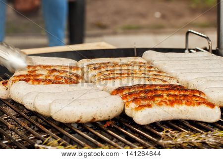 Summer picnic outdoor. Grill sausage on the barbecue-party