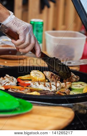 Preparation of a variety of vegetables on the barbecue-party at the summer picnic outdoors