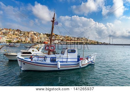 Harbour of Sitia town with parked fishing boats on Crete island, Greece