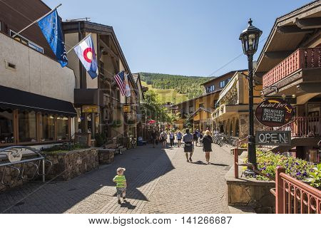 Vail, USA - September 10, 2015: Street in Swiss style at resort town of Colorado with people