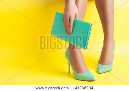 sexy woman legs weared in stylish stiletto shoes;