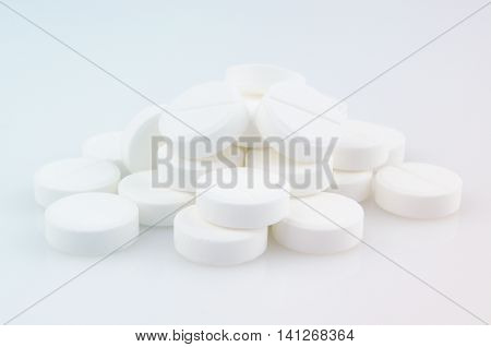 Close-up. Pharmacy theme, white medicine tablets antibiotic pills.