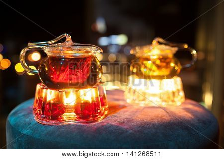 Two Glass Teapots With Candle Heaters;