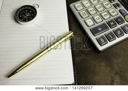 Compass pen and calculator there are other items in your desktop