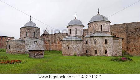Russian medieval castle in Ivangorod. Located on the border with Estonia, not far from St. Petersburg. The photo shows the ancient church. Photographed on a cloudy day.