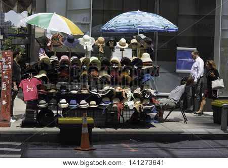 New York NY USA -- Aug 3 2016 A street vendor in Manhattan displays hats for sale. Editorial Use Only