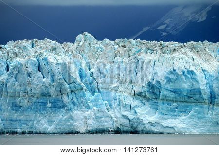 Hubbard tidewater Glacier's blue ice on a cloudy day. Alaska and Yukon