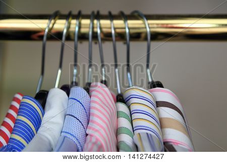 Closeup Of Collars Of Men's Shirts Hanging On A Rail