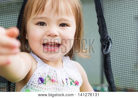 Close Up Of Toddler Girl On Her Trampoline
