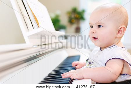 Baby Girl Playing The Piano