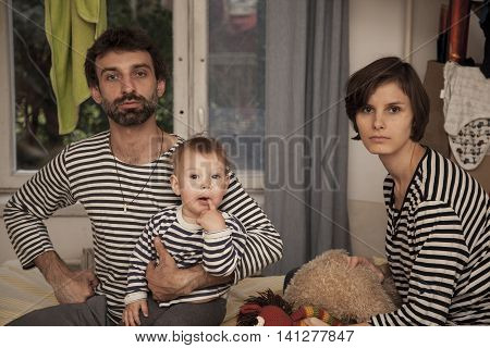 the portrait of one happy striped family