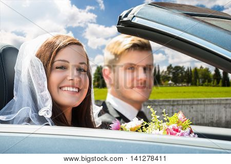 Portrait Of Young Just Married Couple In The Car
