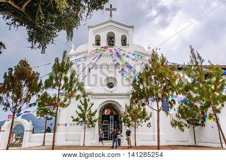 San Lorenzo de Zinacantan, Mexico - March 25 2015: San Lorenzo de Zinacantan church in indigenous Tzotzil Maya village with religious blend of traditional animist belief & Catholicism near San Cristobal de las Casas, Chiapas
