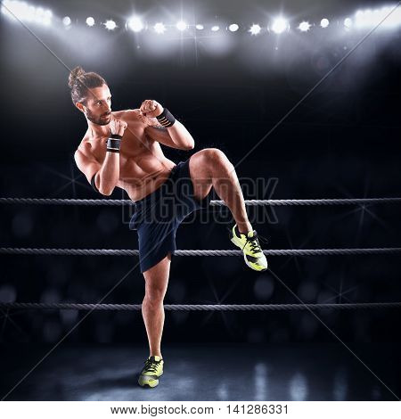 Man on ring ready to fight with opponent