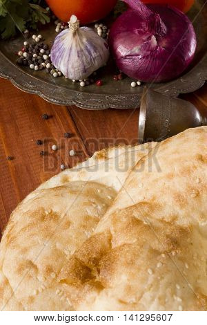 Traditional uzbek flatbread and a set of spices