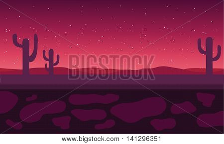 Silhouette of cactus in field at the night scenery