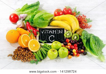 Foods High In Vitamin C On Wooden Board.