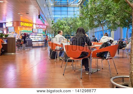 SINGAPORE - CIRCA NOVEMBER, 2015: people at Singapore Changi Airport. Changi Airport  is the primary civilian airport for Singapore and one of the largest transportation hubs in Southeast Asia.