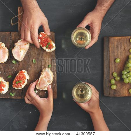 loving couple celebrates an important date with wine and hors d'oeuvres for wine top view