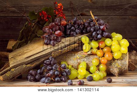 a sprig of grapes on wooden background delicious fruit