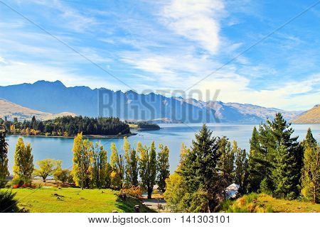 Great scenic of Queenstown light blue water of lake Wakatipu and shade of green by the trees