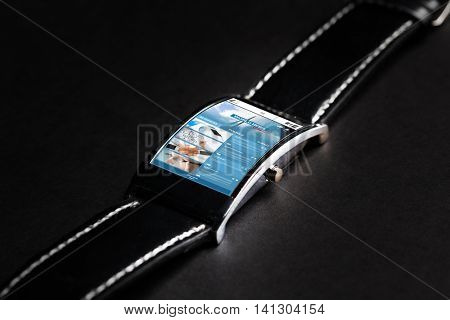 modern technology, mass media, object and media concept - close up of black smart watch with business news on screen