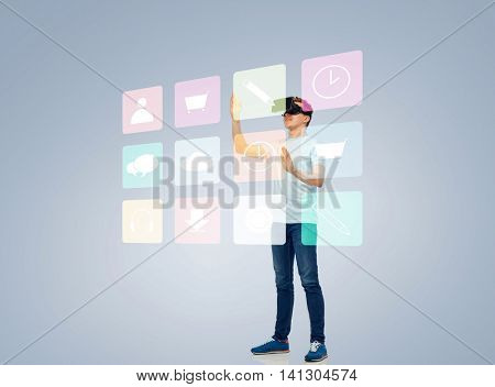 3d technology, virtual reality, entertainment, cyberspace and people concept - happy young man with virtual reality headset or 3d glasses playing game and touching screen with menu icons