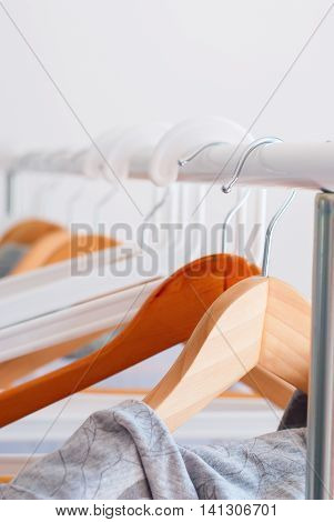 Pastel Gray Female Clothes On Open Cloth Rail