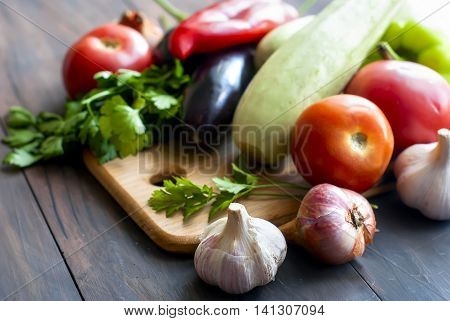 Assorted Fresh Vegetables Ratatu - Peppers, Eggplant, Zucchini, Garlic And Herbs On The Table