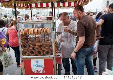 Istanbul - September 1 2014: Street vendor sells traditionale fresh Turkish bagels in the city centre of Istanbul. A snack that is famous in Turkey