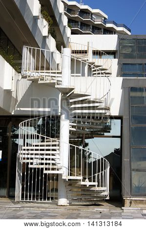 A small spiral staircase on the building