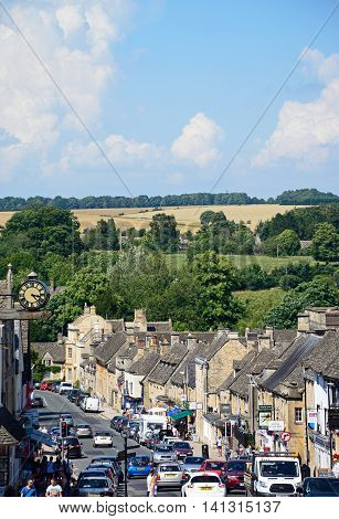 BURFORD, UNITED KINGDOM - JULY 20, 2016 - View along The Hill shopping street towards the countryside Burford Cotswolds Oxfordshire England UK Western Europe, July 20, 2016.