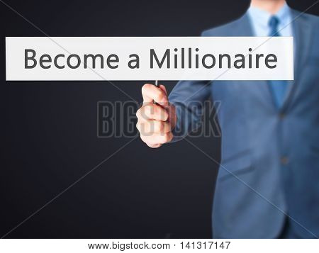 Become A Millionaire - Businessman Hand Holding Sign