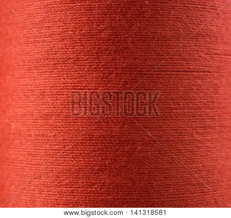 Closeup red thread textile texture for background.