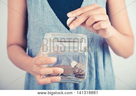 hands holding piggy bank show money dollar bills and coin in piggy bank. business savings finance concept