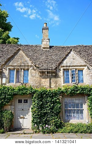 BURFORD, UNITED KINGDOM - JULY 20, 2016 - Wysdom Cottage at the bottom of The Hill shopping street Burford Oxfordshire England UK Western Europe, July 20, 2016.